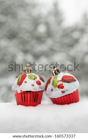 two toy cakes on snow
