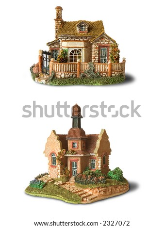 Two toy house on white background (isolated)