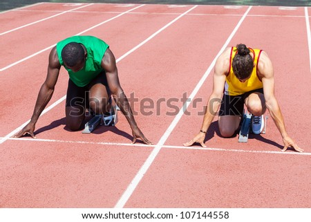 Two Track and Field Athletes before the Race Start - stock photo