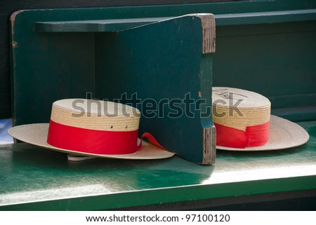 Two traditional Gondolier's straw hats on a bench - Venice, Venezia, Italy, Europe - stock photo