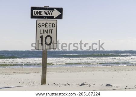 Two traffic signs together for those who would drive on the beach in St. Augustine, Florida, USA - stock photo