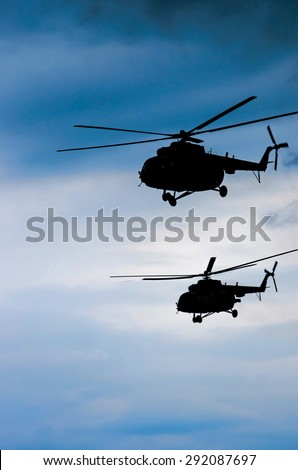 two transport helicopters