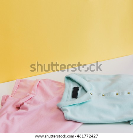 two trendy t-shirts on white table