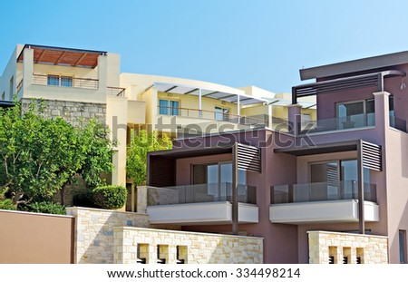 Two tropical apartment buildings with balconies. - stock photo