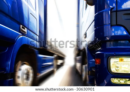 two trucks on the road