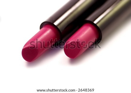 two tubes of red lipstick against white background