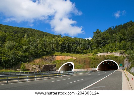 Two tubes tunnel on highway between Zagreb and Rijeka in croatia - stock photo