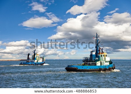 Two Tugs Heading out to Sea in Gdynia, Poland.
