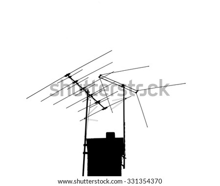 Two TV antennas backlit against a white sky. Very high Contrast. - stock photo