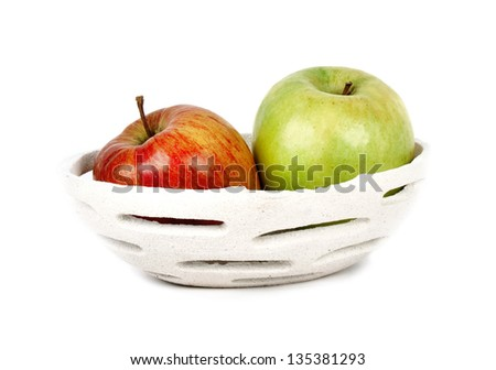 two types of apples, red and green, in a modern ceramic bowl