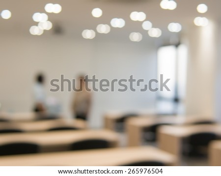 Two unidentified persons talking in meeting room  - stock photo