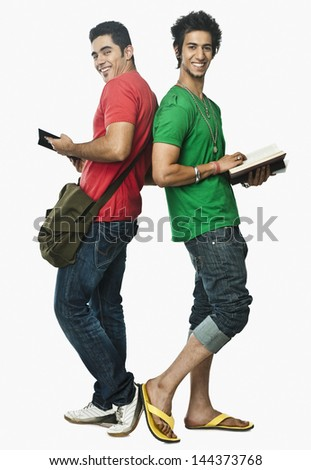Two university students reading books back to back - stock photo