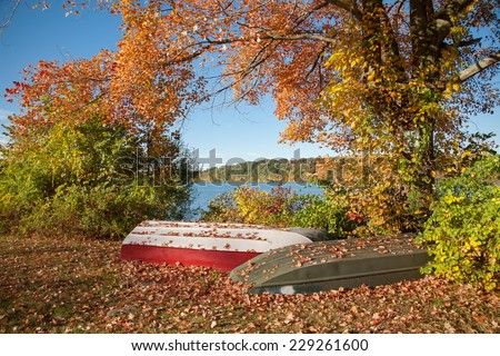 Two unused row boats next to the lake in Putnam County, NY. - stock photo