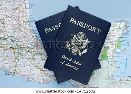 Two US American passports over map of Mexico, Caribbean, selective focus - stock photo