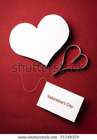 two valentine's paper hearts with a blank business card on a red background , valentine's day , day valentine , postcard - stock photo