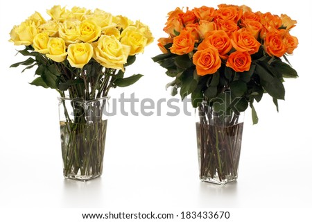 Two Vases of Yellow and Orange Roses - stock photo