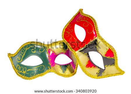 Two Venetian carnival half-mask gold red green black pink asymmetry pattern isolated white background - stock photo