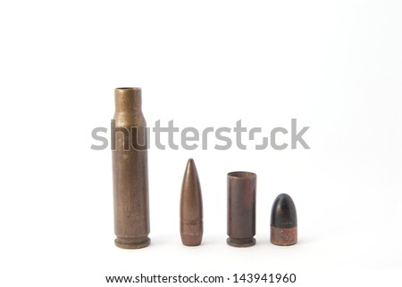 two vertical disassembled rifle ammo