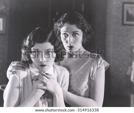 Two very surprised women - stock photo