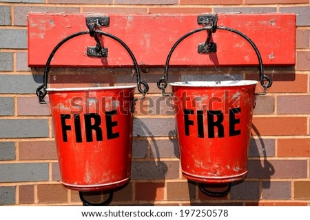 Two Victorian Fire buckets on the railway platform, Brownhills West Railway Station, Staffordshire, England, UK, Western Europe.