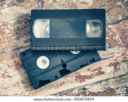 Two video cassette close-up on a wooden surface, retro-style, old, record sound and images