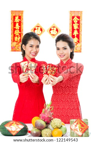 Two Vietnamese congratulating with traditional spring festival
