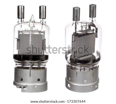 two views of vacuum electronic radio tubes isolated on white - stock photo