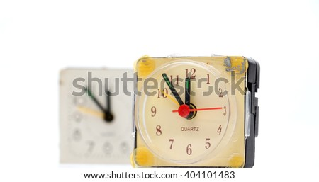two vintage damaged alarm clock on white