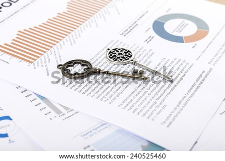 Two vintage keys on the graph paper(document)s for business. - stock photo