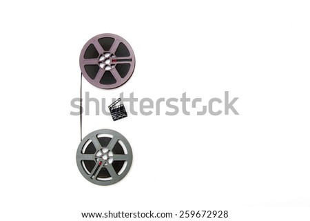 Two vintage 8mm purple and grey movie reels vertically connected with film and small clapper board isolated on white background