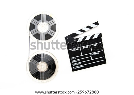 Two vintage 8mm reels vertically connected with film and clapper board isolated on white background - stock photo