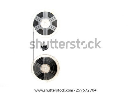 Two vintage 8mm reels vertically connected with film and little clapper board isolated on white background - stock photo