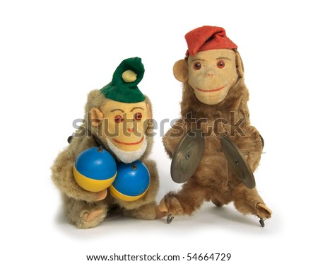 Two vintage wind-up monkey toys with maracas and cymbals - stock photo