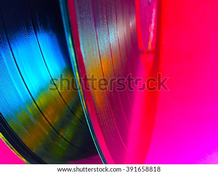 Two vinyl records with saturated colors and copy space - stock photo