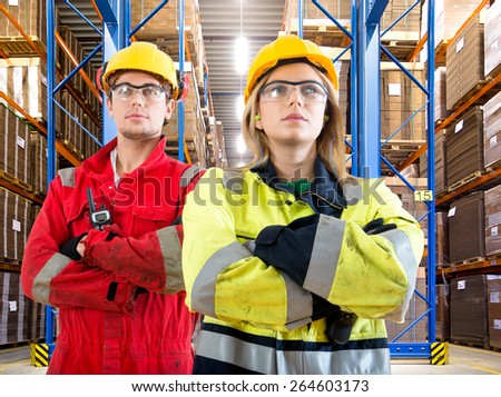 Two warehouse logistics employees looking confident as the new delivery arrives