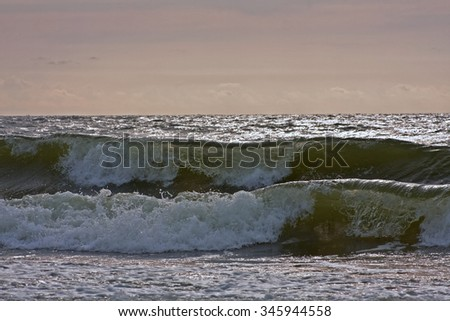 Two waves (Tandem of two waves at the surf line)
