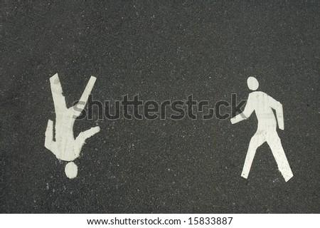 two way pedestrian walkway symbols on dark grey asphalt background - stock photo