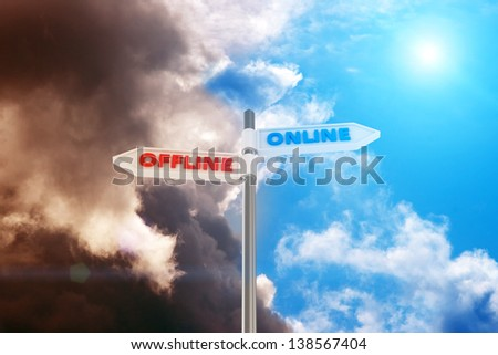 Two way pointer Online and Offline against contrast sky - stock photo