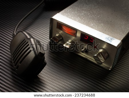two way radio and microphone on a graphite sheet background - stock photo