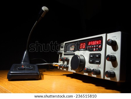 Two way radio and microphone that are on desk - stock photo