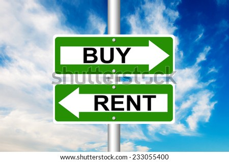 Two way street road sign pointing to Buy and Rent with a blue sky in a background - stock photo