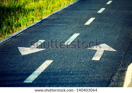 Two way traffic arrows. Cross processing effects. - stock photo