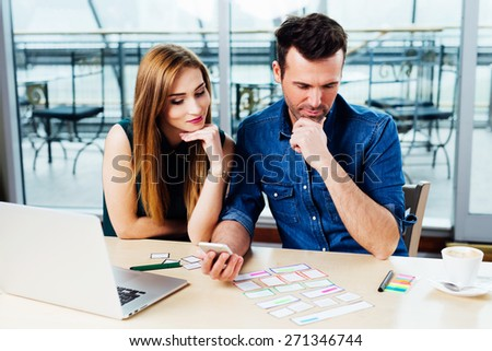 Two web designers thinking about the best ideas for a website with responsive design - stock photo