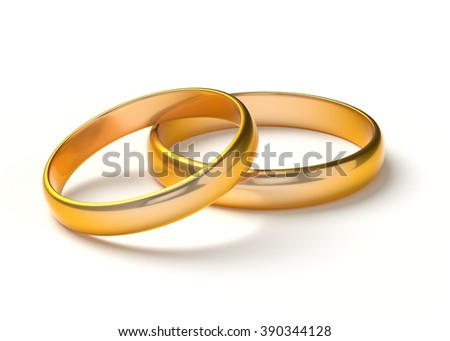 Two wedding gold rings lie on each other isolated on white