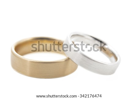 Two wedding rings isolated on white background, shot taken with shallow DOF