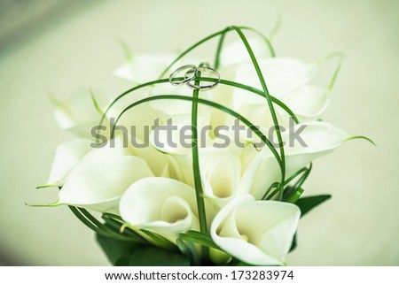Two wedding rings on a bouquet.
