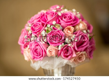 Two wedding rings on a bouquet. - stock photo