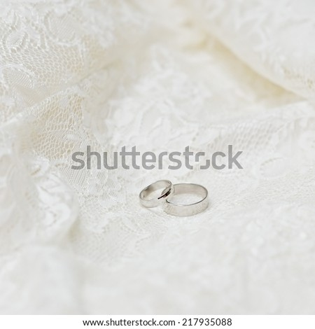 Two wedding rings on a white background  - stock photo
