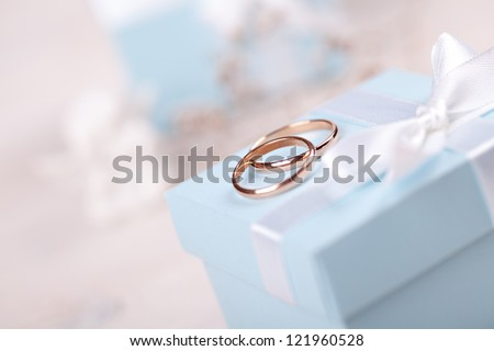 Two wedding rings on blue box - stock photo