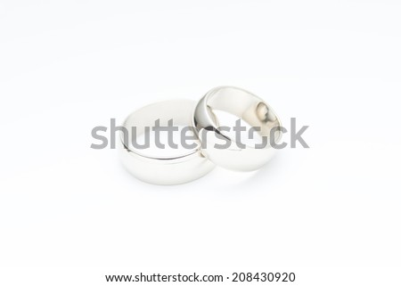 Two wedding rings on white background - stock photo